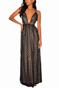 8895dd038a6c Večerné dámske šaty so vzorom - čierne empty